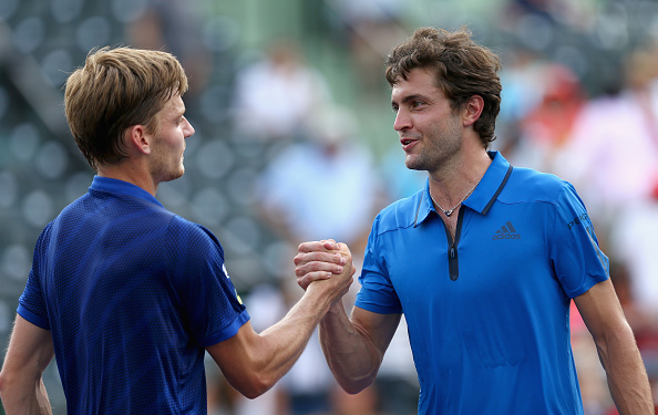 David Goffin shakes hands at the net after his three set victory against Gilles Simon in their quarter final match during the Miami Open (Photo:Clive Brunskill/Getty Images)