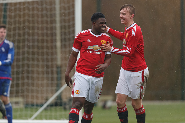 Tyler Reid (left) celebrates after finding the back of the net for Manchester United's under-18s. (Photo: Matthew Ashton - AMA/WBA FC via Getty Images)