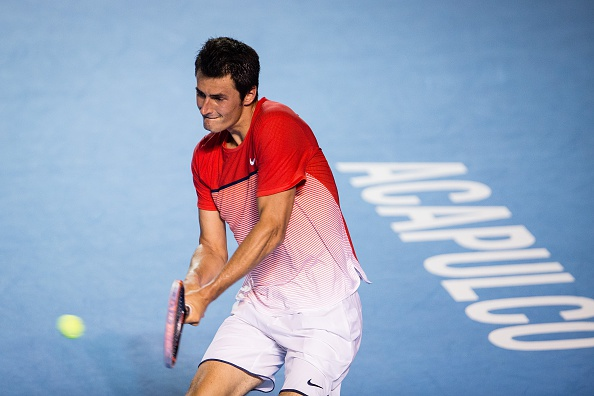 Bernard Tomic hits a backhand return on Saturday (Photo: Getty Images)