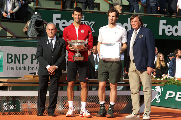 FFT President Jean Gachassin, winner Novak Djokovic, finalist Andy Murray, Adriano Panatta pose during the the trophy ceremony following the Men's Singles final of the 2016 French Open (Photo: Jean Catuffe/Getty Images)
