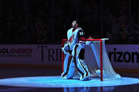 Louis Domingue #35 of the Arizona Coyotes looks on during the National Anthem against the Pittsburgh Penguins at Consol Energy Center on February 29, 2016 in Pittsburgh, Pennsylvania. (Photo by Matt Kincaid/Getty Images)
