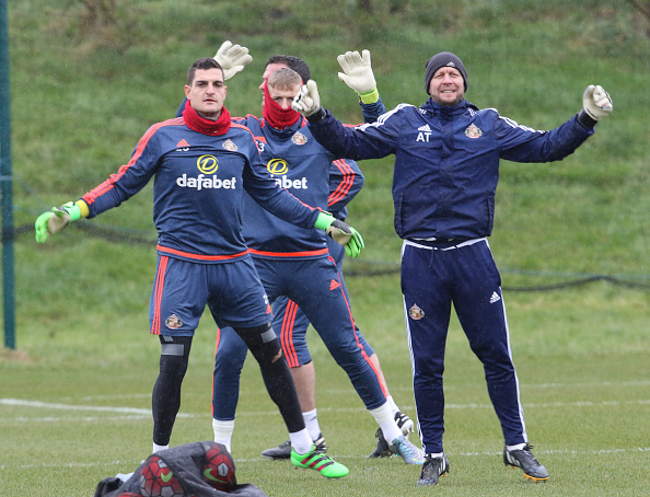 Keeping coach Adrian Tucker (R) warms up the three keepers Vito Mannone, (L) Jordan Pickford and Steven Harper (rear) during a Sunderland training session at the Academy of Light on March 09, 2016 in Sunderland, England. (Photo by Ian Horrocks/Sunderland AFC via Getty Images)