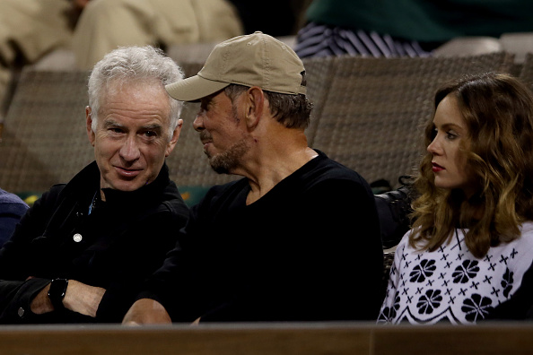 John McEnroe, Larry Ellison and Nakita Kahn watch Serena Williams plays Laura Siegemund of Germany during the BNP Paribas Open at the Indian Wells Tennis Garden on March 11, 2016 in Indian Wells, California. (Photo by Matthew Stockman/Getty Images)