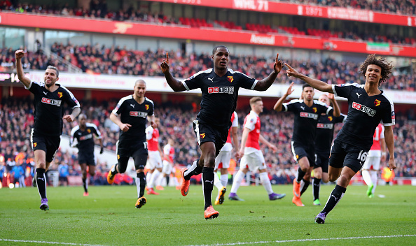 Ighalo (pictured, middle) celebrates his finish to break the deadock, as Watford stung a wounded Arsenal at the Emirates | Photo: Getty