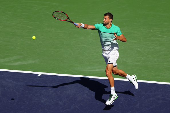 Dimitrov levels the match one set a piece | Photo courtesy of: Julian Finney/Getty Images