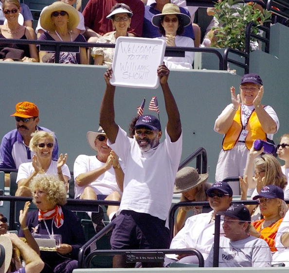 Serena and Venus' father, Richard Williams, celebrates both of his daughters as they face off in the 1999 final. Credit: Robert Sullivan/Getty Images