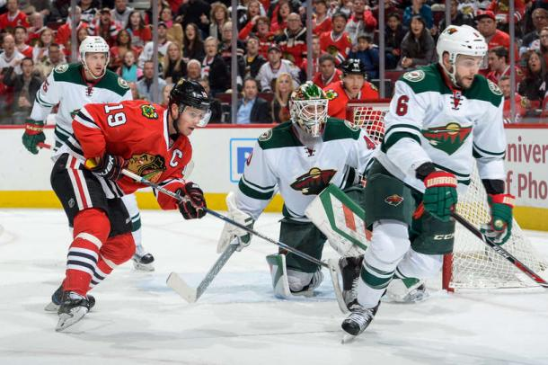 Jonathon Toews #19 and Marco Scandella #6 watch for the puck. Source: Bill Smith- NHLI via Getty Images
