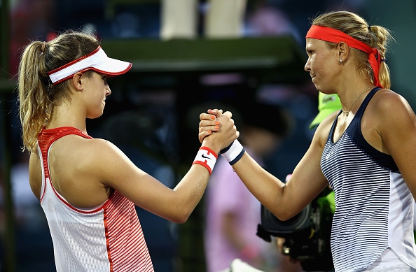 Lucie Hradecka of the Czech Republic shakes hands at the net after her three set victory against Eugenie Bouchard of Canada in their first round match during the Miami Open Photo: Getty Images Sport / Clive Brunskill