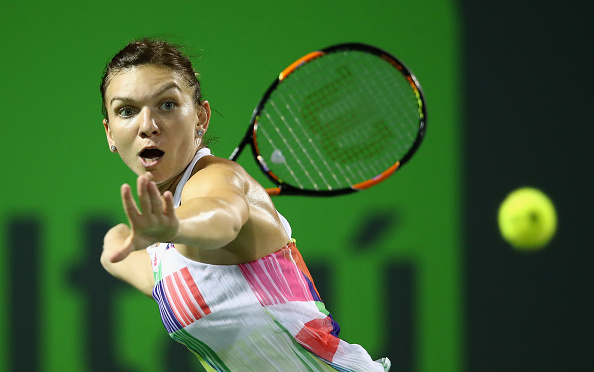 simona Halep of Romania plays a forehand against Daria Kasatkina of Russia in their second round match during the Miami Open. | Photo: Getty Images Sport, Clive Brunskill