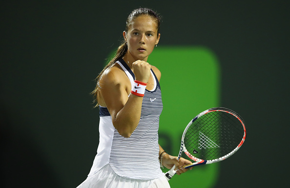Daria Kasatkina of Russia celebrates a point against Simona Halep of Romania in their second round match during the Miami Open.  | Photo: Getty Images Sport, Clive Brunskill