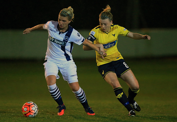 Danielle Carlton (left) resists the pressure of Oxford United's Katherine Nutman. (Photo by Ben Hoskins - The FA/The FA via Getty Images)