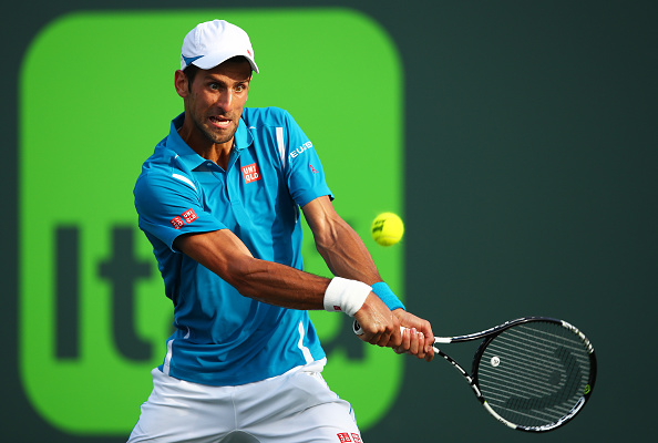Novak Djokovic of Serbia plays a backhand against Joao Sousa of Portugal in their third round match during the Miami Open Presented by Itau at Crandon Park Tennis Center on March 27, 2016 in Key Biscayne, Florida. (Photo by Clive Brunskill/Getty Images)