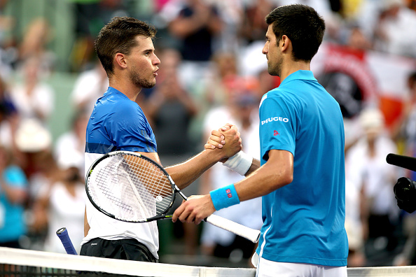 Dominic Thiem shakes hands after losing to Novak Djokovic at the Miami Open. Photo: Matthew Stockman / Getty Images