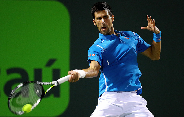 Novak Djokovic cracks a forehand in his 6-3, 6-3 quarterfinal win over Tomas Berdych at the Miami Open/Getty Images