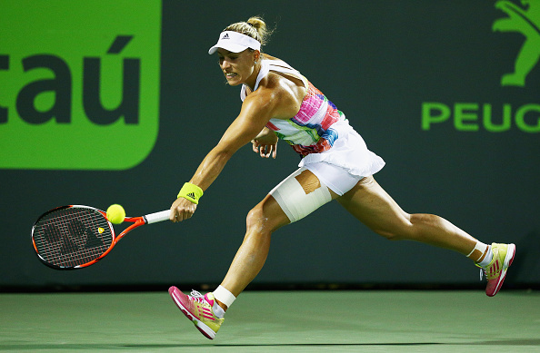 Kerber breaks at the most important time to keep herself in the match | Photo courstesy of: Clive Brunskill