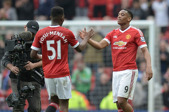 Martial and Fosu-Mensah after the Everton game | Photo: Oli Scarff/AFP/Getty Images
