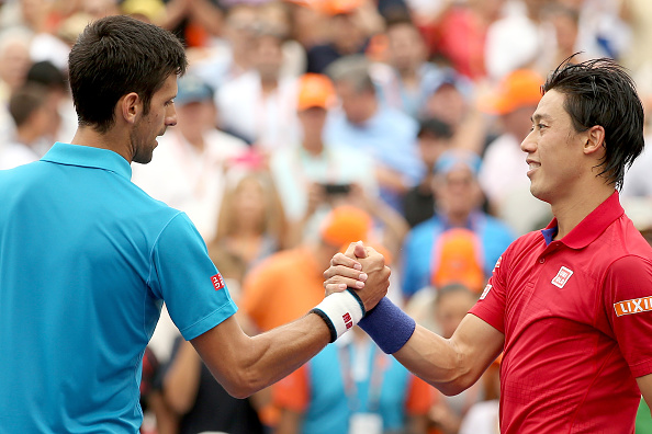 Novak Djokovic and Kei Nishikori shake hands after the Miami Open final/Getty Images