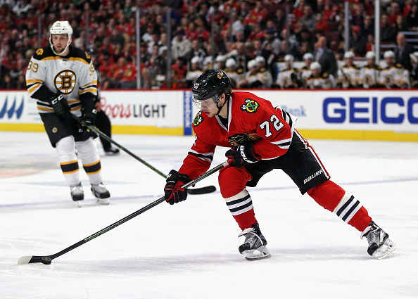 Artemi Panarin #72 of the Chicago Blackhawks controls the puck against the Boston Bruins at the United Center on April 3, 2016 in Chicago, Illinois. The Blackhawks defeated the Bruins 6-4. (Photo by Jonathan Daniel/Getty Images)