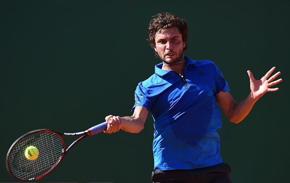 Gilles Simon hits a forehand during his first round match at the Monte Carlo Rolex Masters/Getty Images