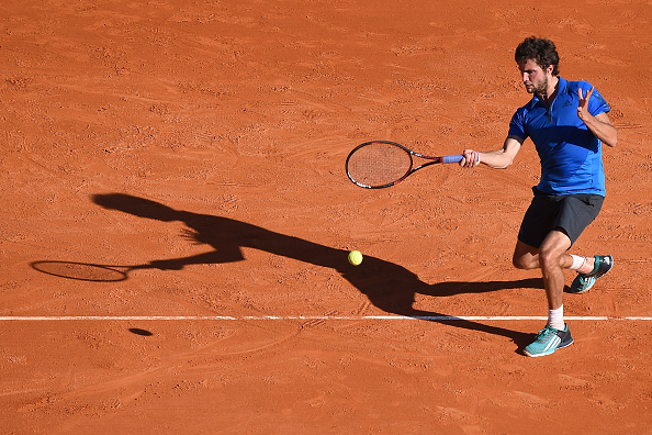 Gilles Simon strikes a forehand on the classic, red clay courts of Monte Carlo at the Monte Carlo Rolex Masters/Getty Images