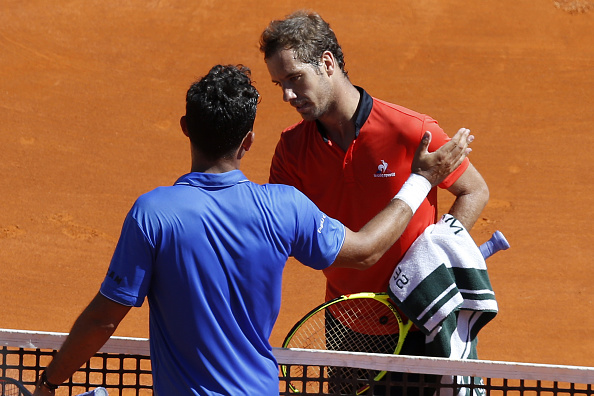 Nicolas Almagro congratulates Richard Gasquet at the net (Photo:Valery Hache/Getty Images)