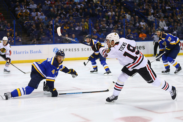 ST. LOUIS, MO - APRIL 13: Jonathan Toews #19 of the Chicago Blackhawks controls the puck against Carl Gunnarsson #4 of the St. Louis Blues in Game One of the Western Conference Quarterfinals during the 2016 NHL Stanley Cup Playoffs at the Scottrade Center on April 13, 2016 in St. Louis, Missouri. (Photo by Dilip Vishwanat/ Getty Images)