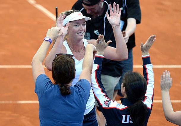 The American team congratulates Vandeweghe after her win over Stosur in the World Group Play-offs tie against Australia last year. Photo credit: Bradley Kanaris/Getty Images.
