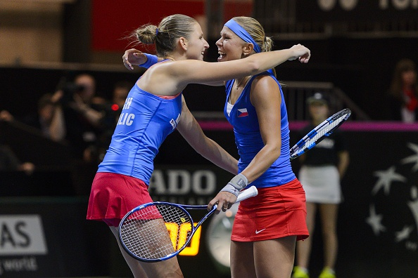 Pliskova (left) and Hradecka (right) hug after converting match point to send their home nation into the Fed Cup final. Photo credit: Fabrice Coffrini/Getty Images.