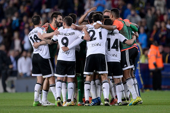 Valencia squad celebrating | Photo: Josep Lago/AFP/Getty Images