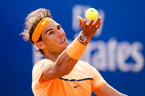 Rafael Nadal tosses a ball before serving at the Barcelona Open Banc Sabadell/Getty Images