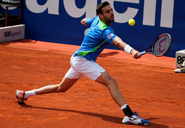 Marcel Granollers slides into a backhand at the Barcelona Open Banc Sabadell/Getty Images