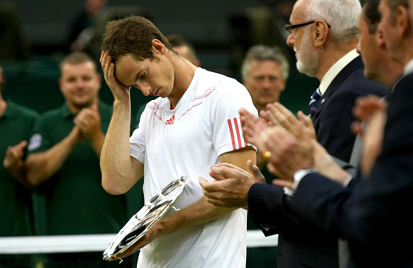 Andy Murray looks down after his defeat against Roger Federer at Wimbledon 2012. (Photo by AMA/Corbis via Getty Images)
