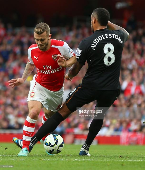 Wilshere against Huddlestone will be a key contest (photo: Getty Images)