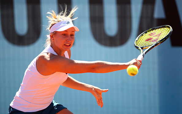 Gavrilova reaches for a backhand in her opening match. Photo credit: Clive Brunskill/Getty Images.