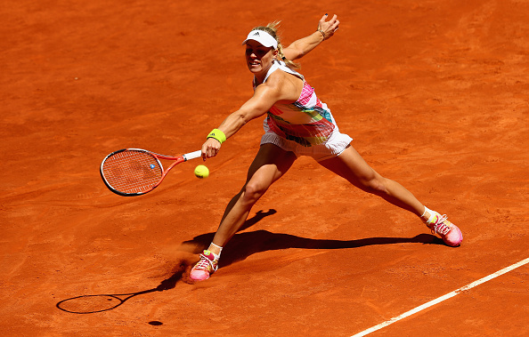 Angelique Kerber slides into a backhand at the Mutua Madrid Open/Getty Images