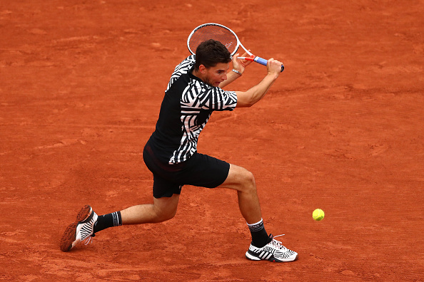 Dominic Thiem hits a backhand slice (Photo: Julian Finney/Getty Images)