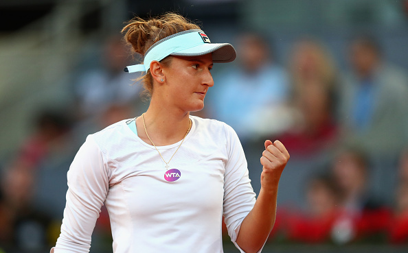 Irina-Camelia Begu celebrates her upset win over Garbine Mugurza at the Mutua Madrid Open/Getty Images