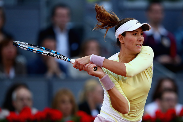 Garbine Mugurza fires a backhand at the Mutua Madrid Open/Getty Images