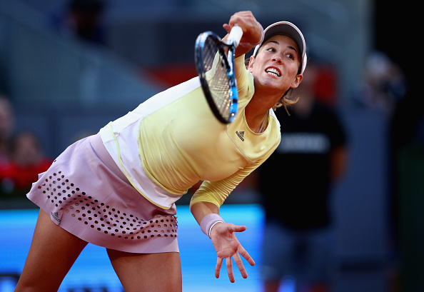 Garbiñe Muguruza serves at the Mutua Madrid Open/Getty Images