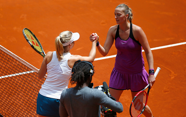 Both players embrace each other at the net after the match concluded. Photo credit: Julian Finney/Getty Images.