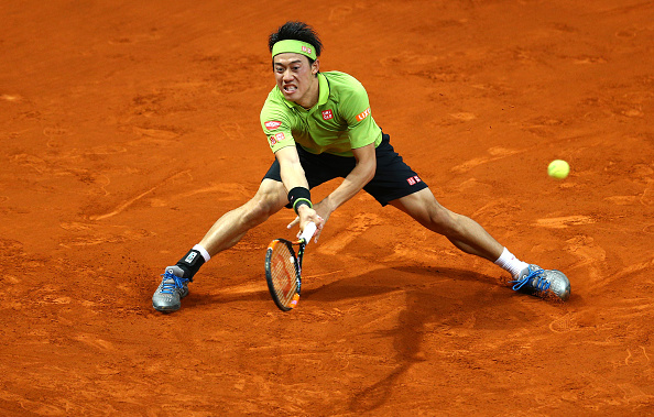 Kei Nishikori slides into a forehand at the Mutua Madrid Open/Getty Images