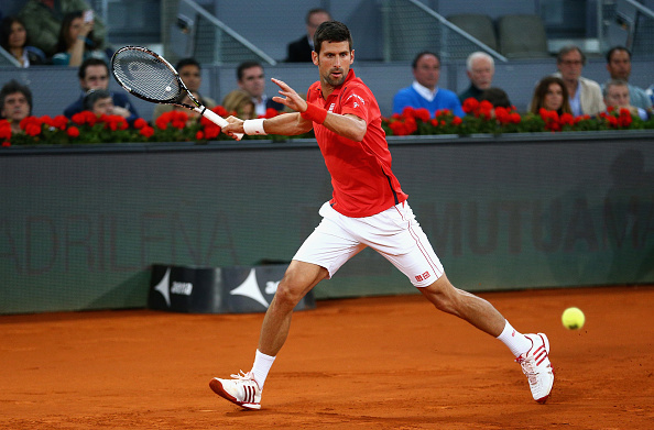 Novak Djokovic hits a forehand at the Mutua Madrid Open/Getty Images