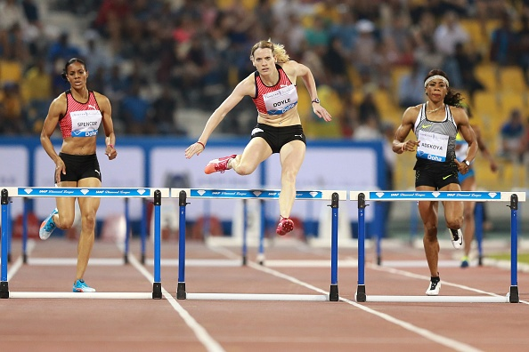 Eilidh Doyle (C) competes in the women's 400 metres hurdles final as at the Diamond League