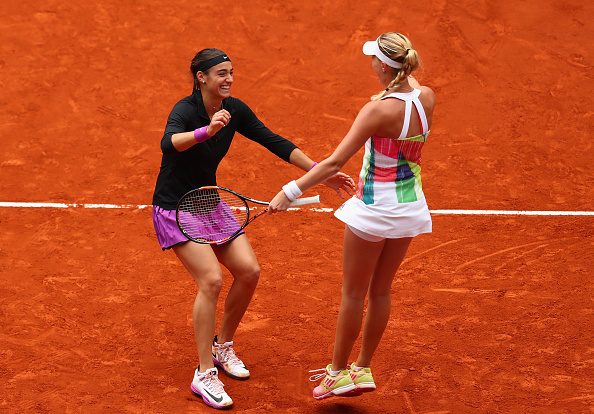 Garcia and Mladenovic celebrate after winning | Photo: Julian Finney/Getty Images