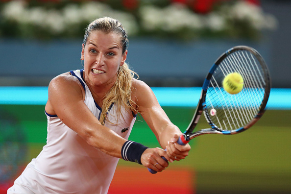 Dominika Cibulkova hits a backhand at the Mutua Madrid Open/Getty Images