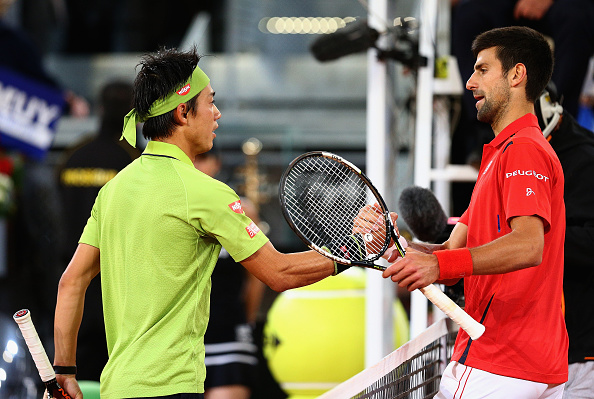 Novak Djokovic and Kei Nishikori shake hands after their semifinal match (Photo: Clive Brunskill/ Getty Images)