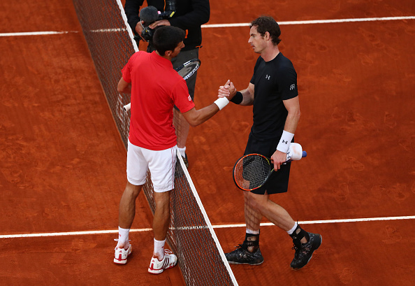 Novak Djokovic is congratulated by Andy Murray following his three set win (Photo: Julian Finney/Getty Images)