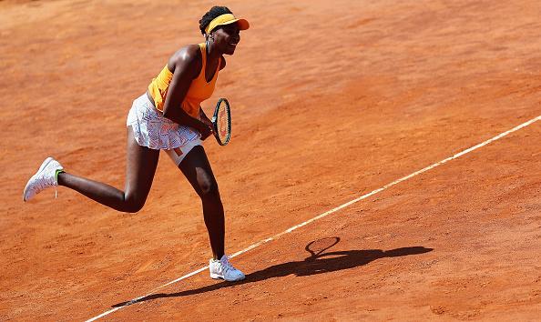 Venus Williams hits a serve at the Internazionali BNL d'Italia in Rome/Getty Images