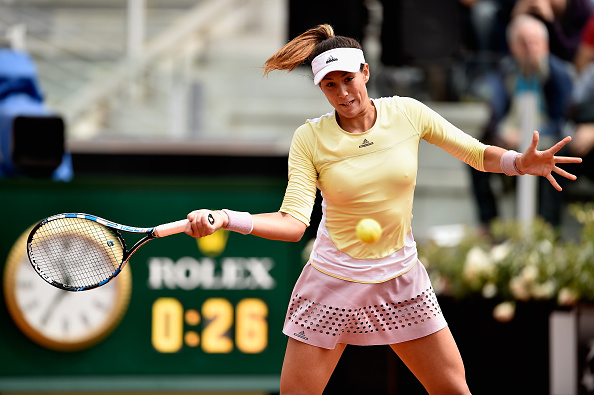 Garbine Muguruza hits a forehand to Jelena Ostapenko during their third round match in Rome/Dennis Grombkowski/Getty Images