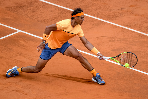 Rafael Nadal slides into a shot at the Internazionali BNL d'Italia in Rome/Getty Images